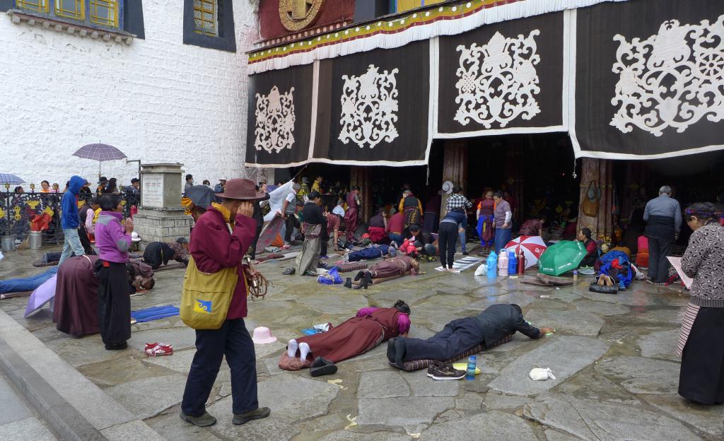 Devout pilgrims prostrating