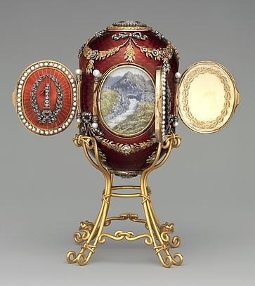 The Caucasus Egg 1893.  The Imperial hunting lodge images revealed when opening 4 pearl bordered doors bearing a diamond set number of the year