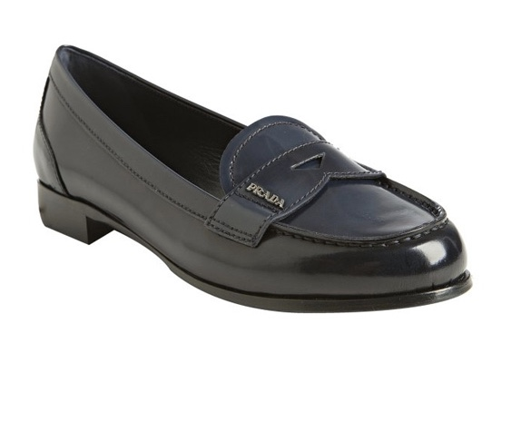 Classic Prada loafer featuring the distinctive span of leather across the saddle with diamond cut out