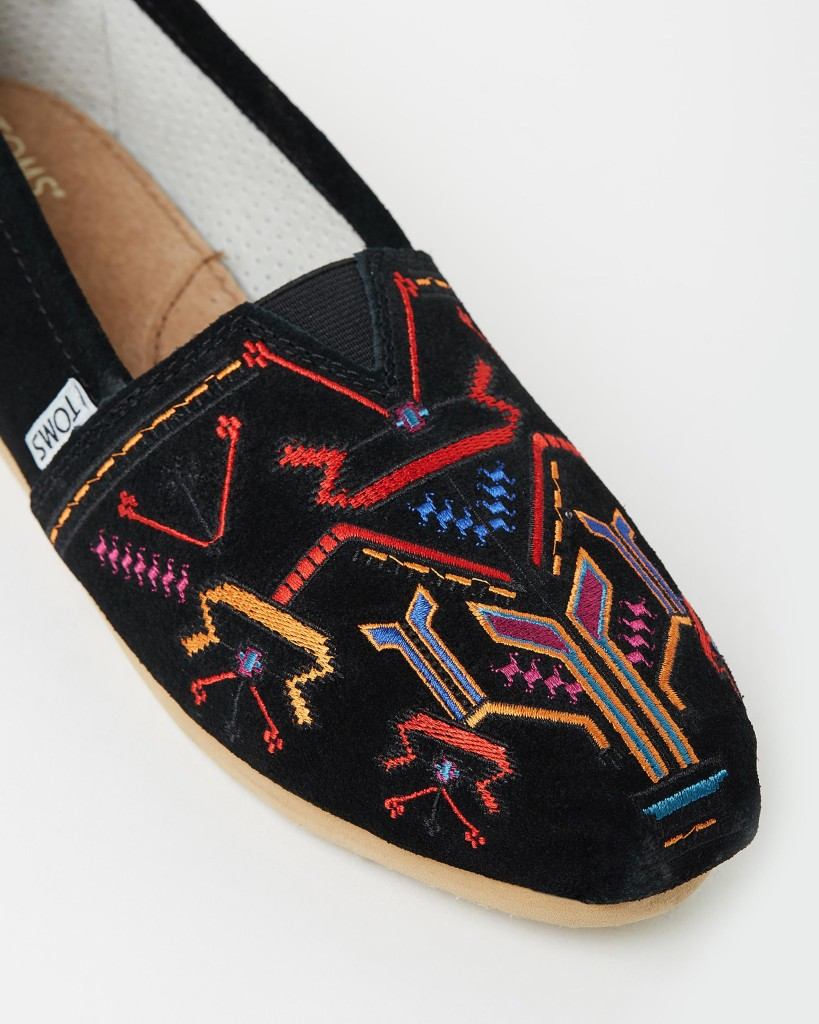 Tribal embroidered front in black suede.  A cushioned suede insole - a signature of the brand
