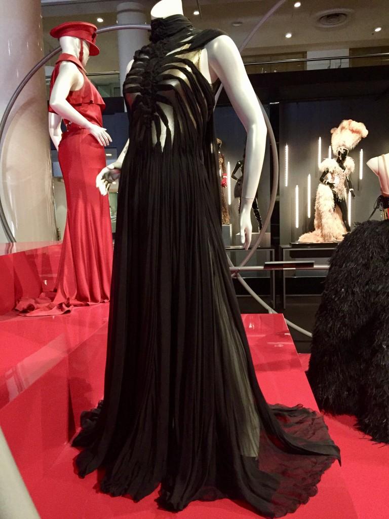 Kylie X2008 Tour   Black silk chiffon dress by Jean Paul Gaultier  Photograph:  GRACIE