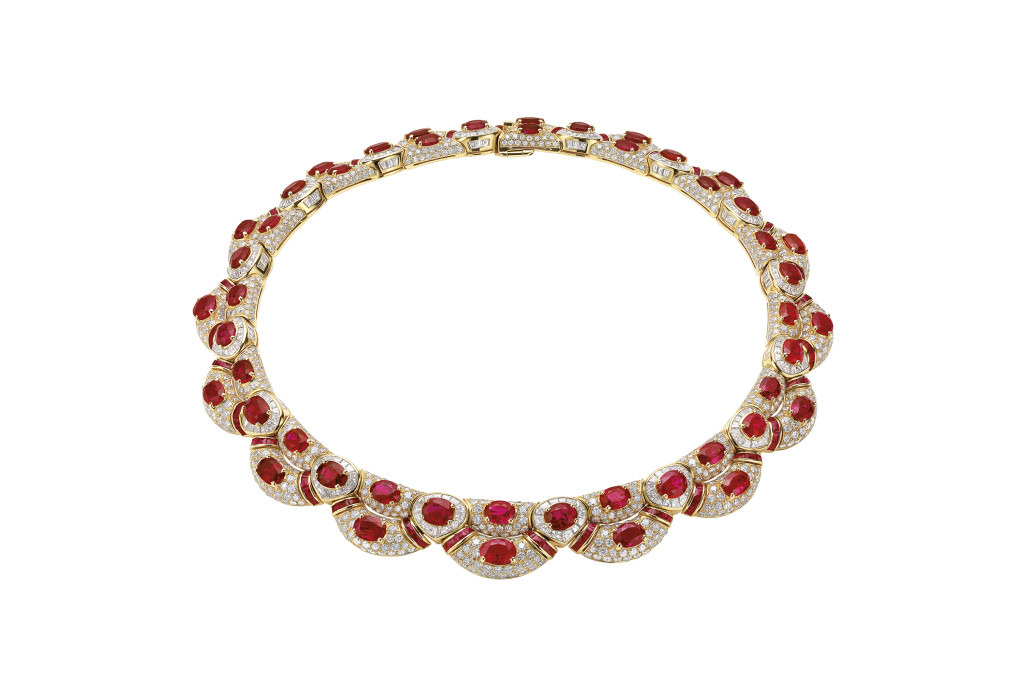 Necklace in gold with rubies and diamonds, 1994. Designed as row of cushion-shaped rubies within a frame of baguette and brilliant-cut diamonds in pavé settings supporting a second row of cushion-shaped rubies framed by diamonds and embellished by calibrated cut rubies. The necklace is set with 48 cushion-shaped rubies for a total weight of 59.33 carats. The necklace and the earrings were worn by Sophia Loren in the film Prêt-à-Porter (1994) by Robert Altman