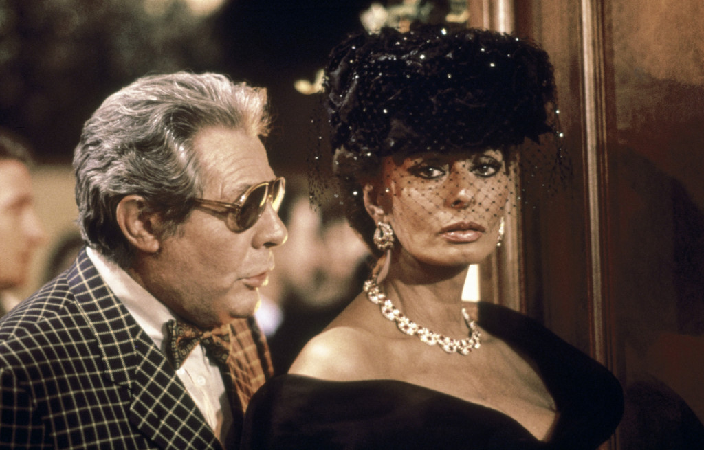 talian actors Sophia Loren and Marcello Mastroianni on the set of the film Prêt-à- Porter (Ready to Wear) (1994), directed by American Robert Altman. Loren wears a Bulgari necklace and earrings in gold with rubies and diamonds Photo © Grazia Neri Photo Agency, Milan