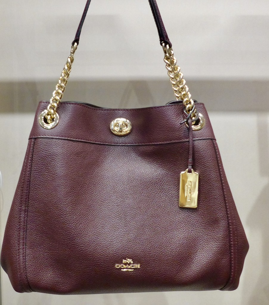 The Edie Shoulder bag in pebble leather with polished turncock and dressy chain handles  Photograph: GRACIE