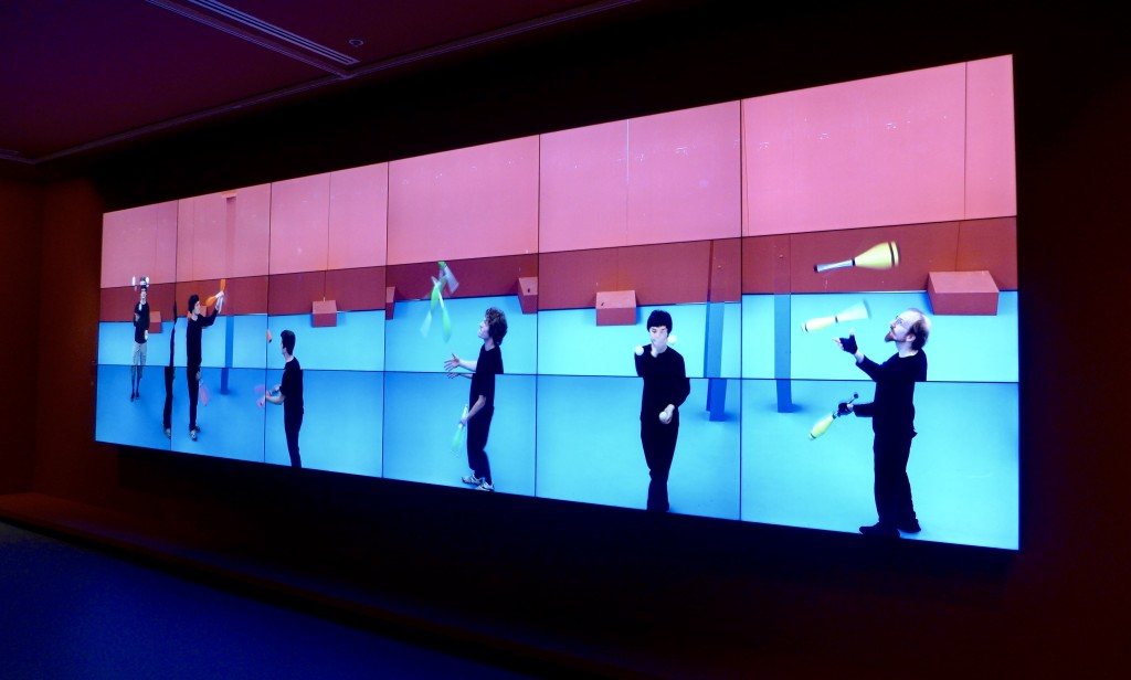 the Jugglers:  An 18 screen, 22 minute video that depicts David Hockney in a room of jugglers.  Photograph:  GRACIE