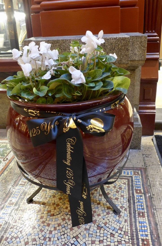 Urns adorn each doorway.  Celebrations ribbons announce the 125th Anniversary  Photograph:  GRACIE