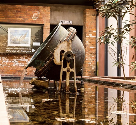 Historic jam pan re-invented as a water feature  in the Atrium  Photograph:  Hotel website