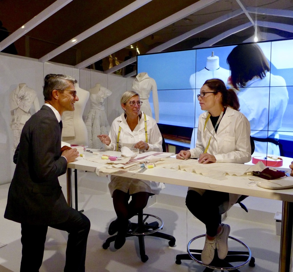 Serge Braunschwig COO of Christian Dior Couture chats with artisans demonstrating their skills Photograph: GRACIE