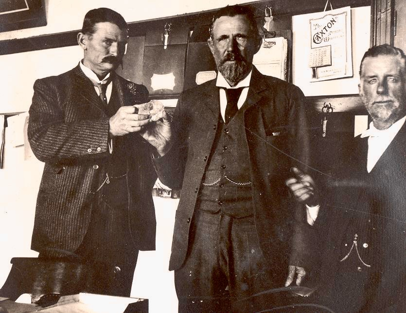 Publicity photo of the Culinan crystal being handed from Frederick Wells (right) to McHarcy, who then passes it to Stir Thomas Cullinan (left).  Image:  Google